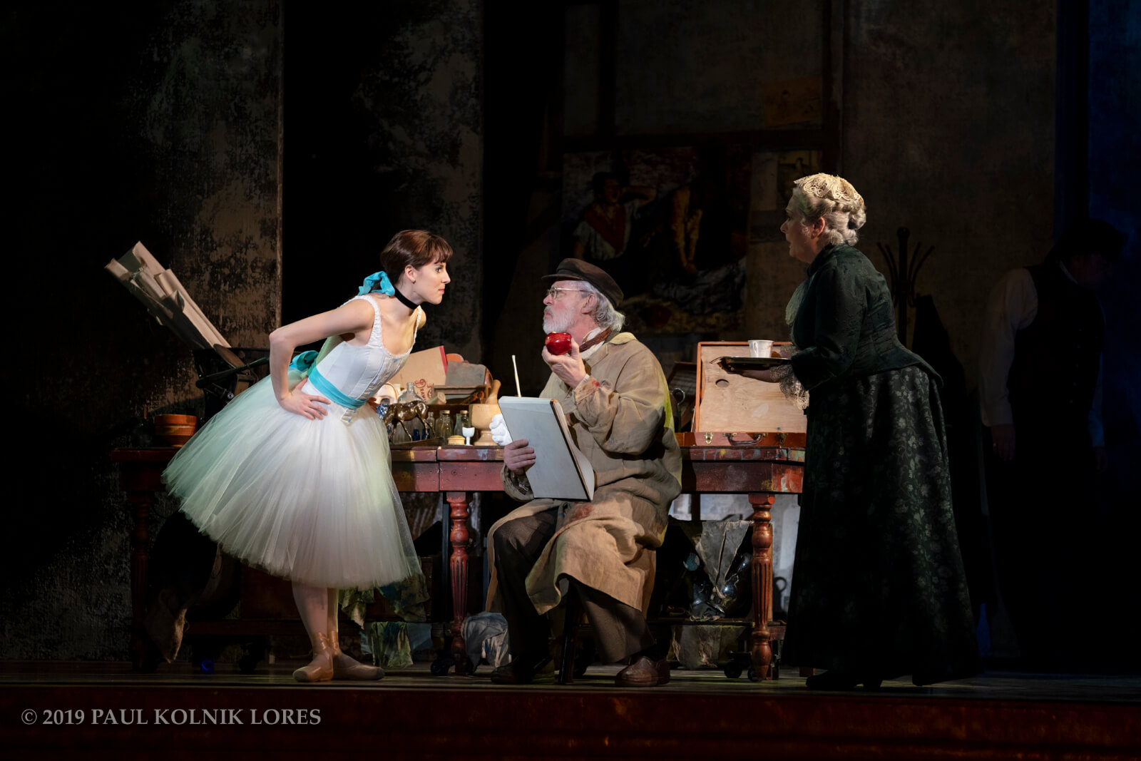 Marie (Tiler Peck) about to steal an apple from Degas (Terrence Mann). Barbara Marineau looks on.