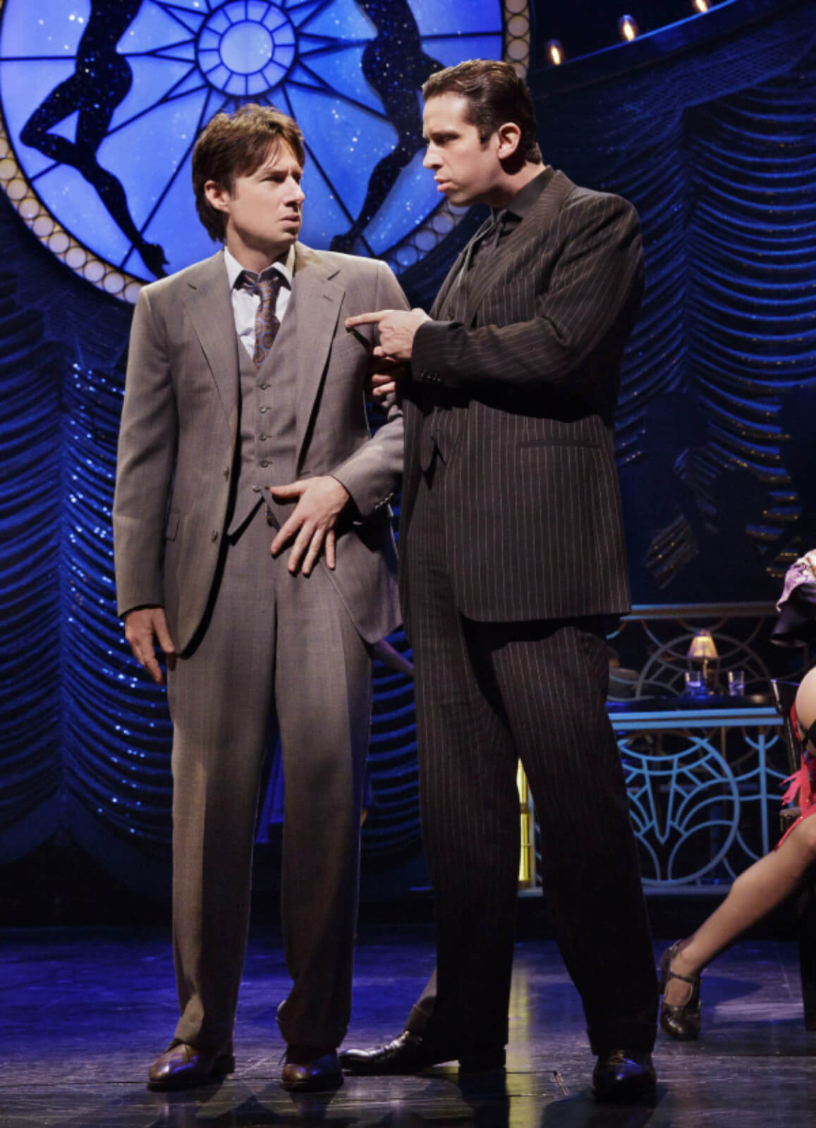Cheech (the tall Nick Cordero in a black pin stripe suit) warns David (the scared Zach Braff in a grey suit) how to write the next scene.