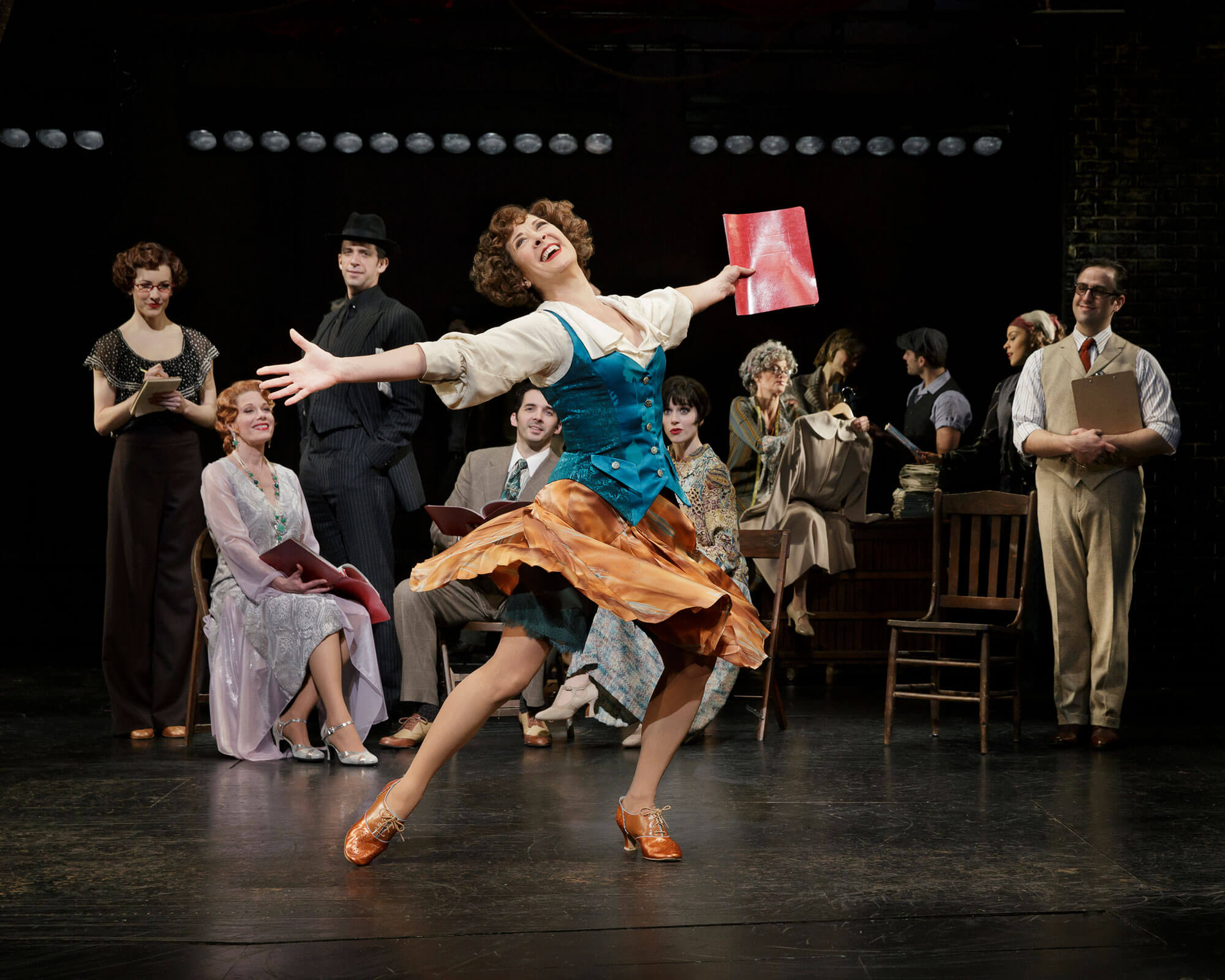 """Eden (Karen Ziemba) joyfully sings """"There's a New Day Comin'! with arms wide open and skirt twirling from a spin of joy!"""