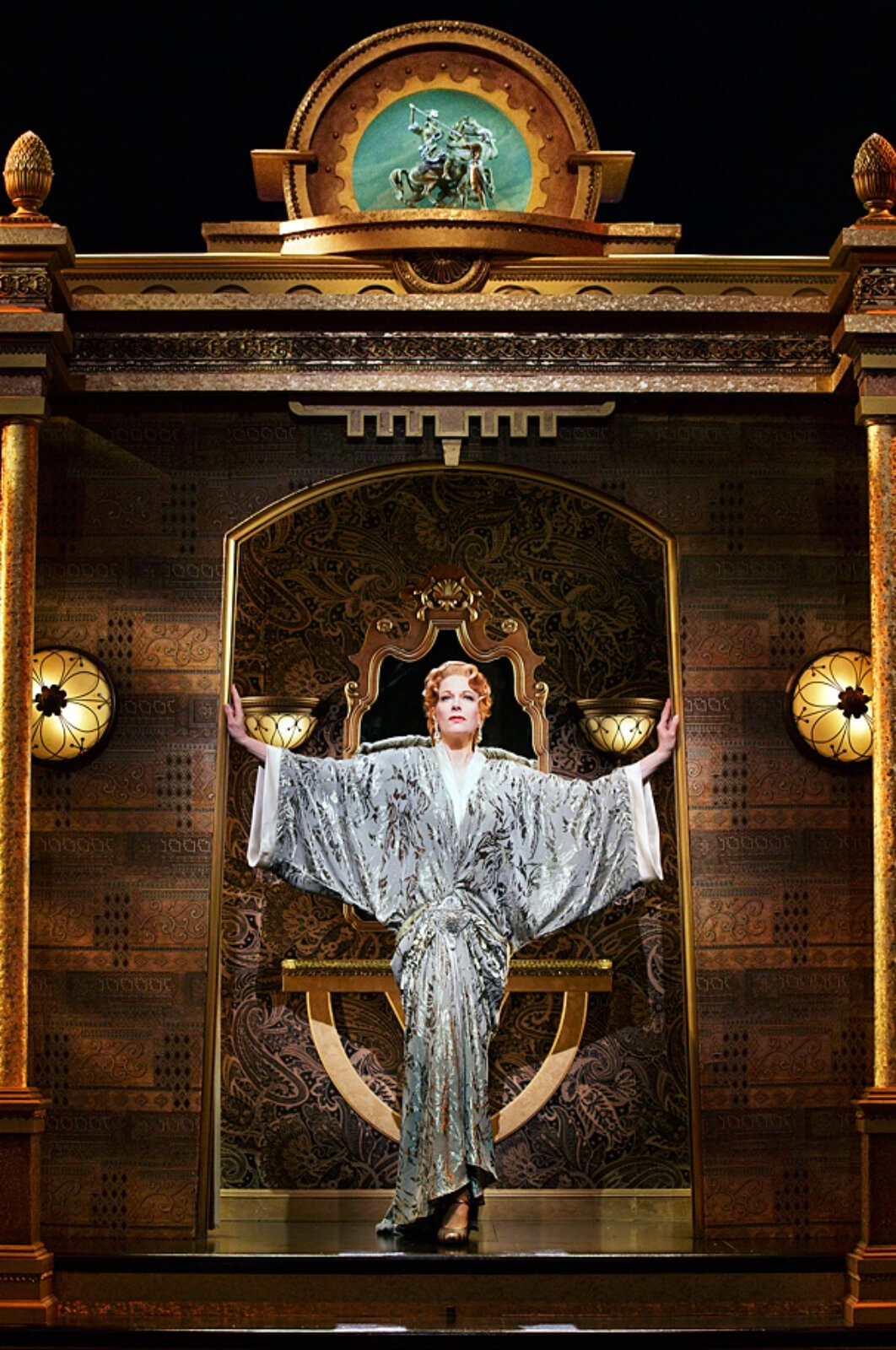 Helen Sinclair (Marin Mazzie) in her first entrance. She stands a doorway in a silver robe.