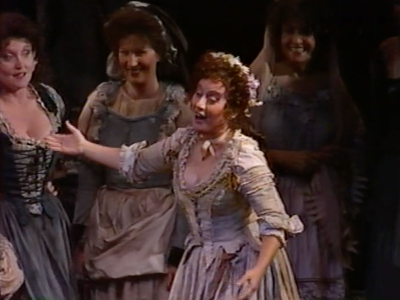 Erie Mills in the role of Zerlina. She is dressed as a peasant woman singing about her wedding to her girl friends in Don Giovanni.