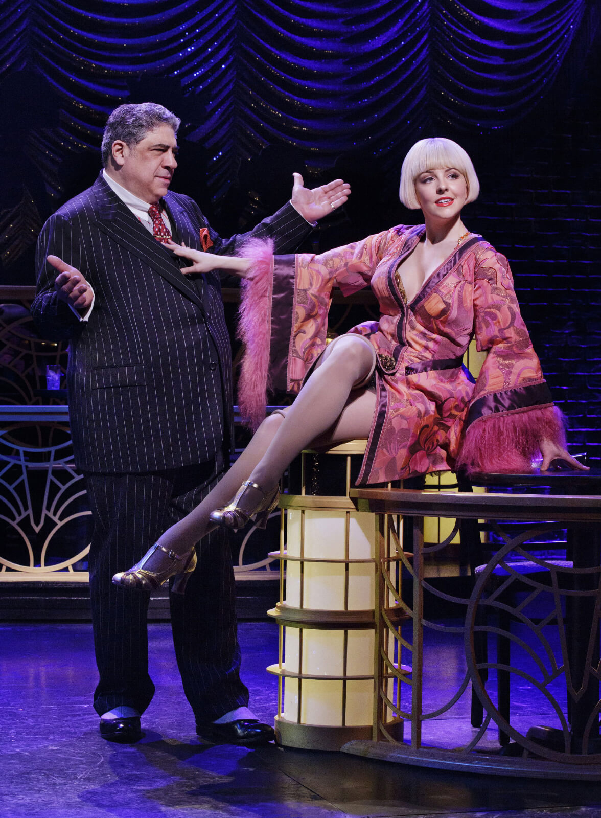 """Nick (Vincent Pastore) and Olive (Heléne Yorke) performing """"Gee, Baby Ain't IGood to You""""."""