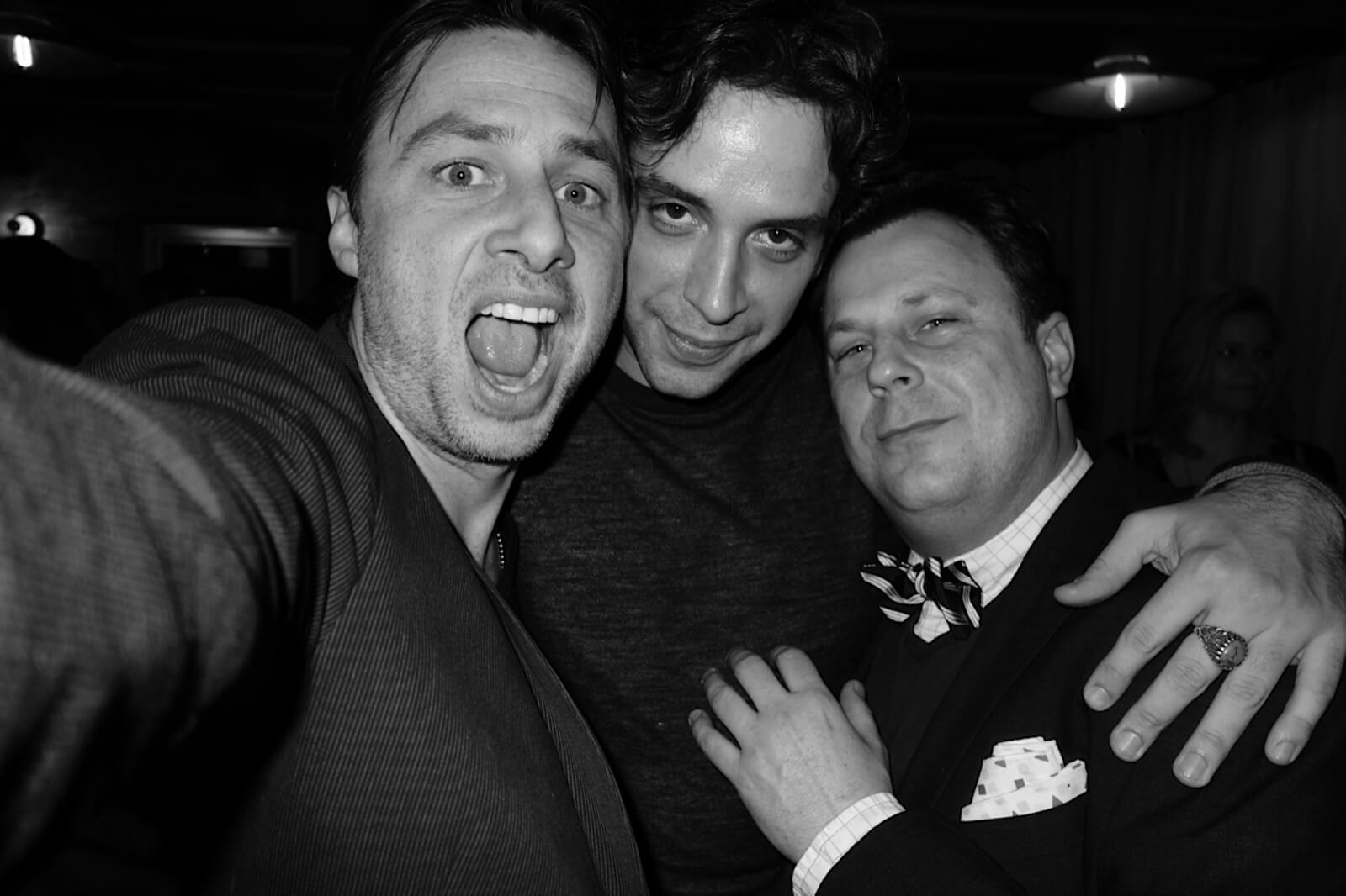 A black and white photo of Zach Braff, Nick Cordero, and Brooks Ashmanskas in street clothes (pictured from left to right).