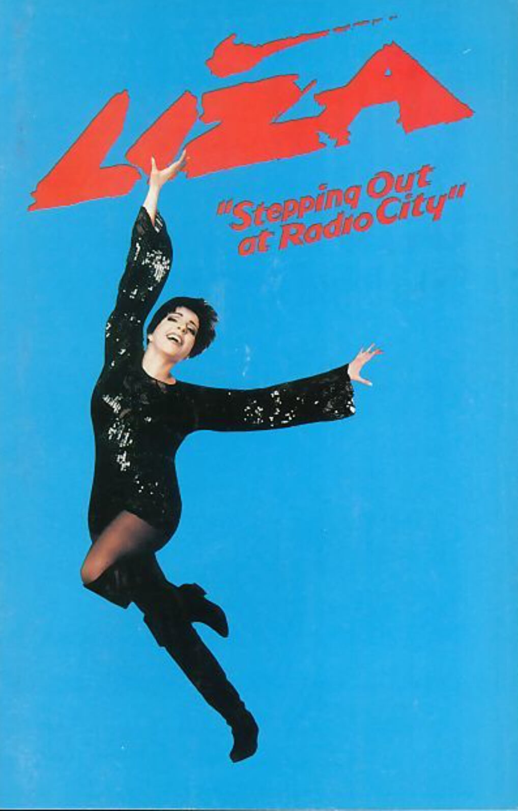 Logo image for Liza: Stepping Out at Radio City. Liza, dressed in a sparkly black dress, on a blue background with the title in red above her.