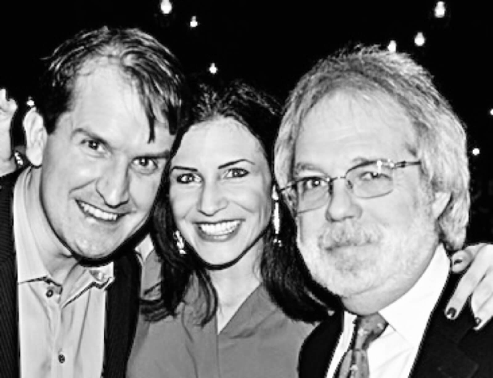 A black and white photo pictured from left to right: James Moye, Jenny Powers, and John Weidman.