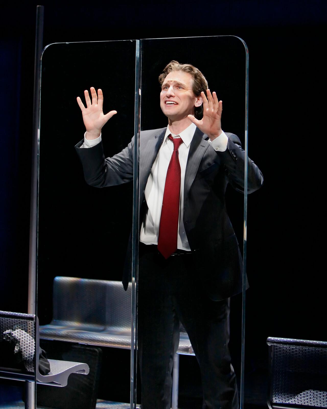 "Zack (Sebastian Arcelus) sings ""Happiness"" he presses his hands on the glass subway doors."