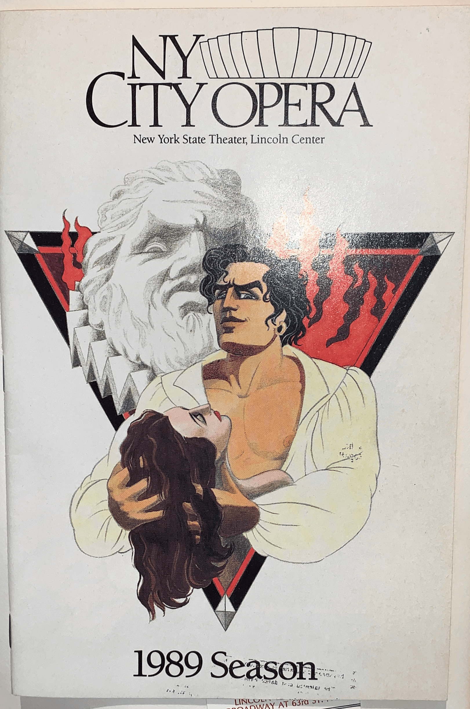 1989 season's Don Giovanni playbill cover art, with NY City Opera: New York State Theater, Lincoln Center written on the upper portion, and 1989 Season on the bottom. A colored photo of the main cast is at the center, with a grayscale sculpture within inverted triangle drawing behind them.