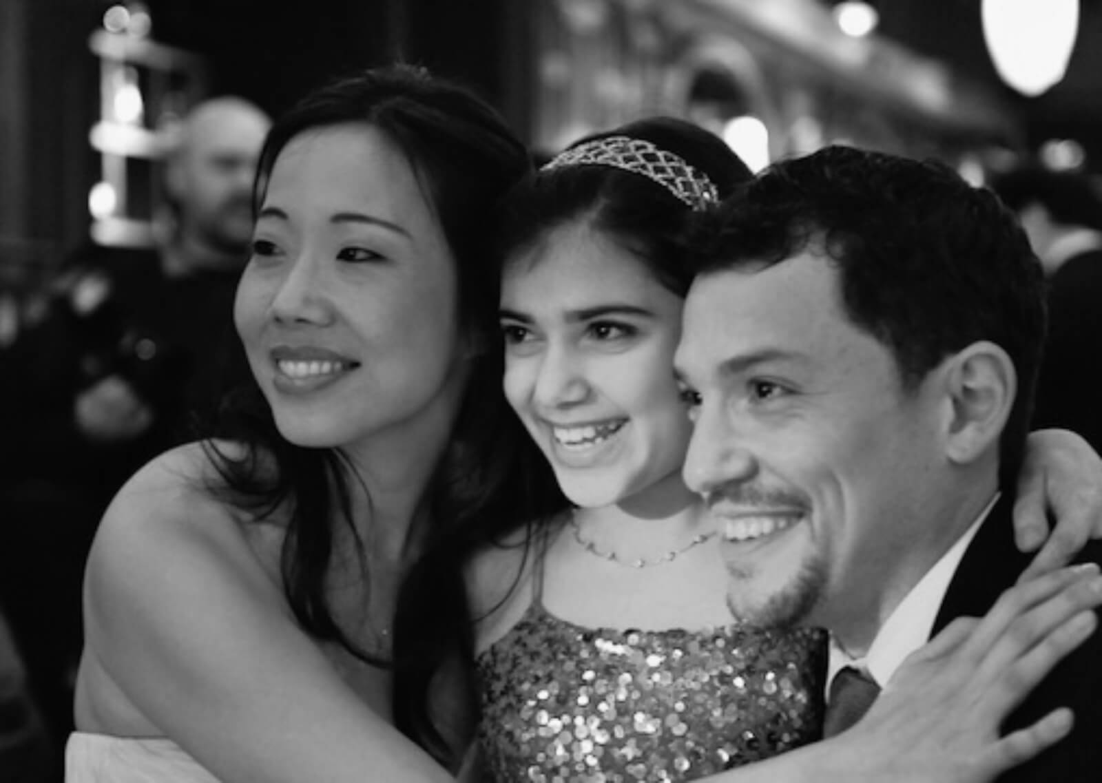 Black and white photo of members of the company in formal attire pictured from left to right: Pearl Sun, Lina Silver, Miguel Cervantes.