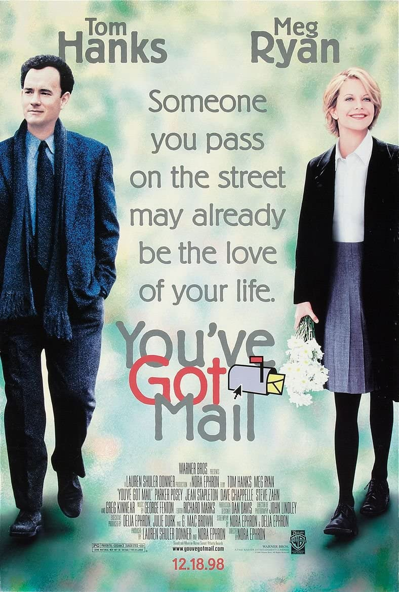 """Movie poster featuring Kathleen Kelly (Meg Ryan) and Joe Fox (Tom Hanks). The title """"You've Got Mail"""" and the list of cast and creatives is written on the poster. The tagline says """"Someone you pass on the street may already be the love of your life."""""""