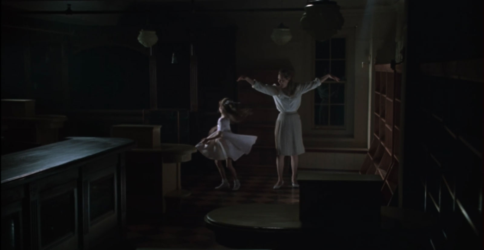 The memory of Kathleen's mother (Kathryn Meisle) and young Kathleen appears. We see them dance together.