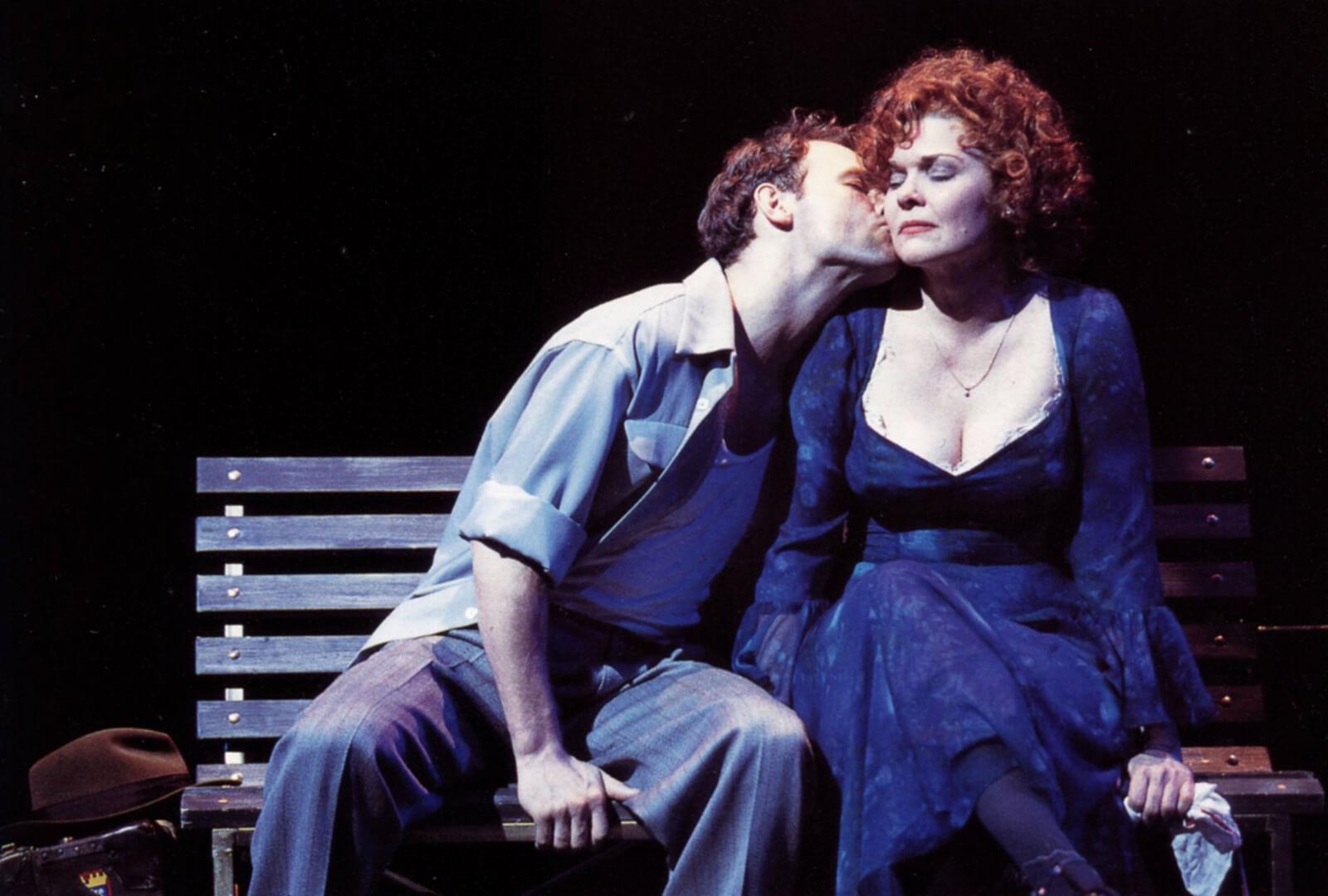 Jim Newman kissing Debra Monk on the cheek.