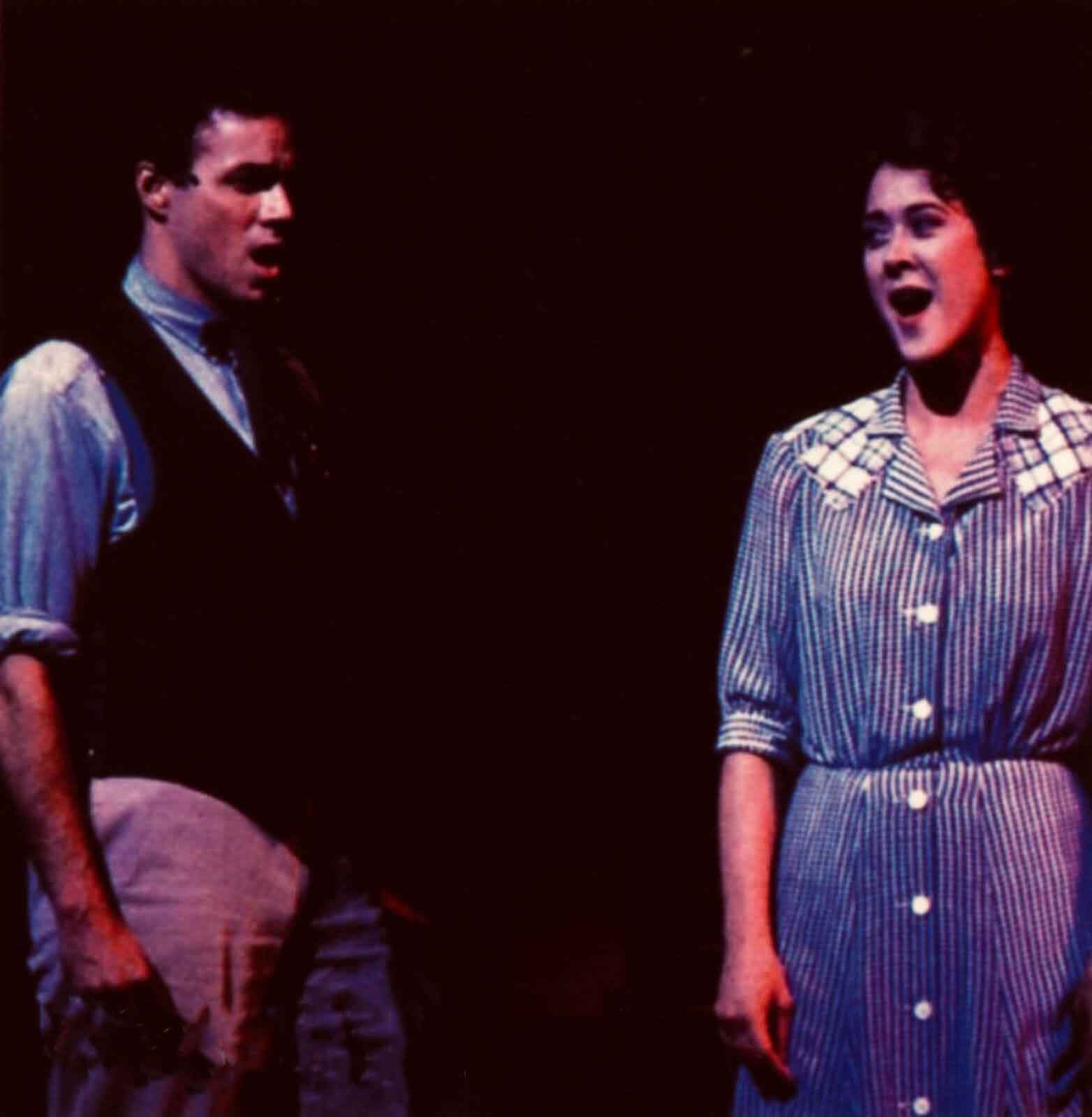 """Richard Muenz and Karen Ziemba singing """"A Man and a Woman"""" in 110 in the Shade. He is the sheriff of the town and she wears a blue house dress."""