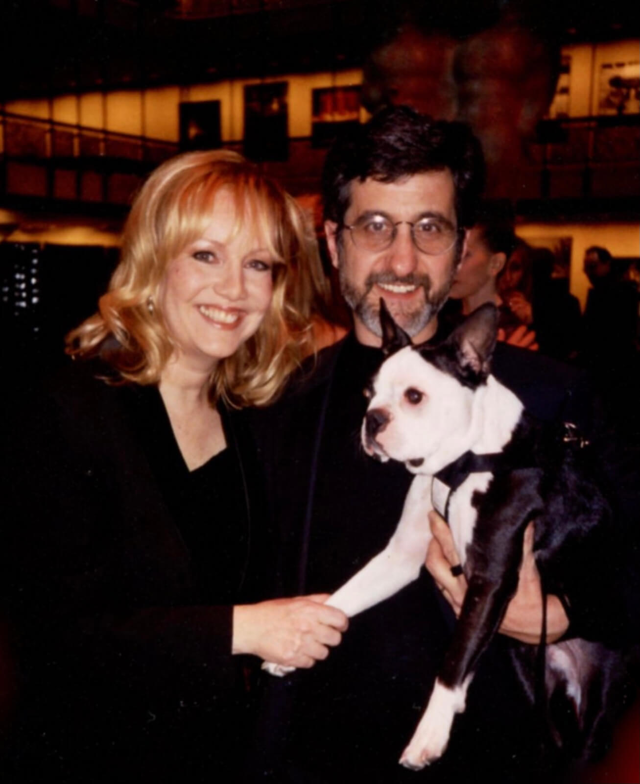 Susan Stroman with Broadway animal trainer Bill Berloni (both dressed in black) holding Pi the Dog.