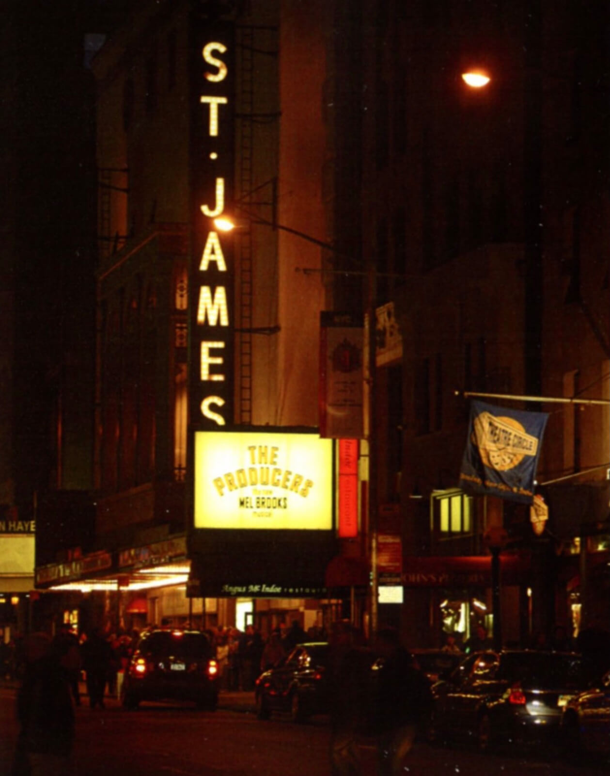 The St. James Theatre at night, showing the marquee of The Producers.