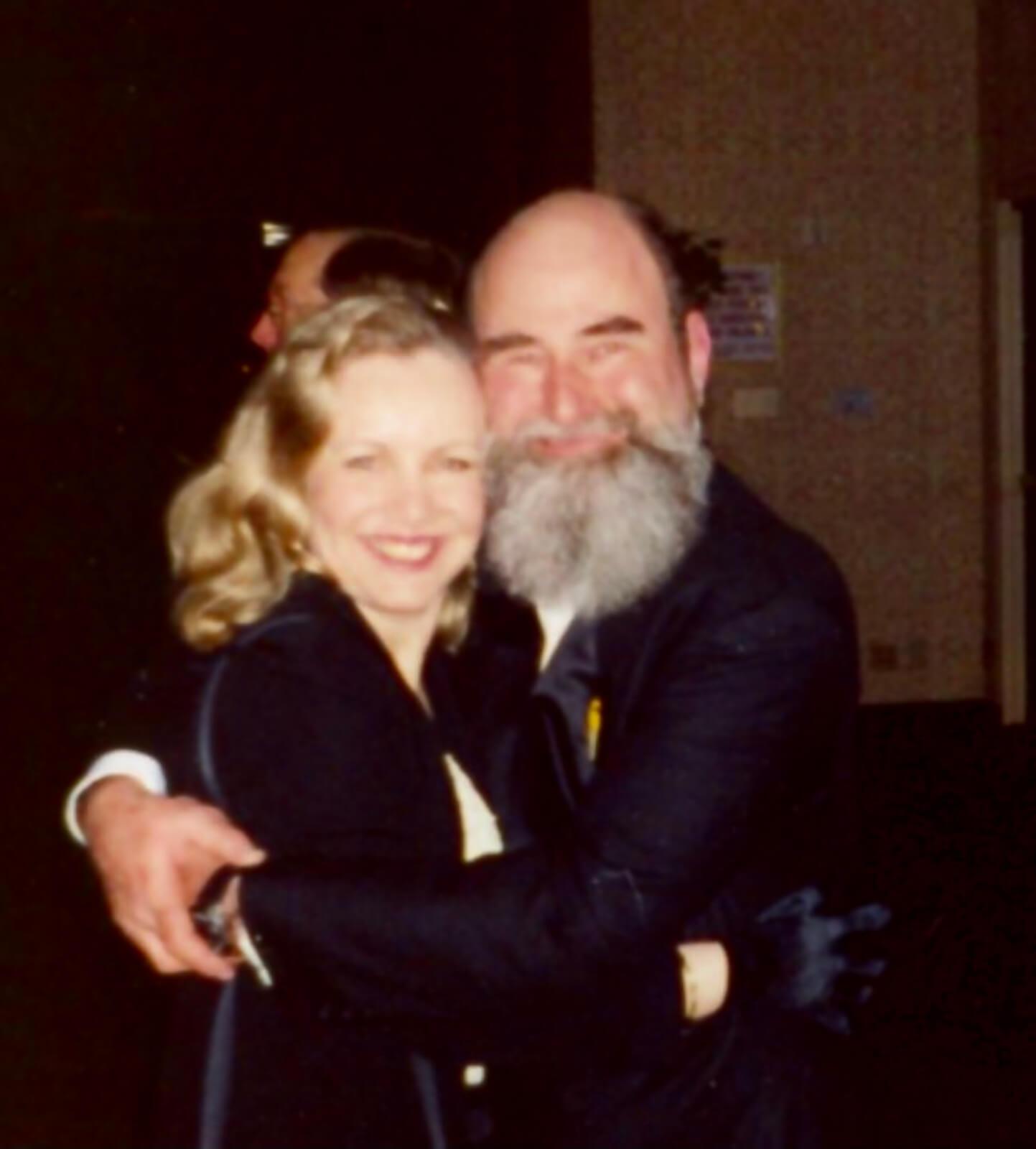 Susan Stroman with Michael David, both elegantly dressed and hugging, on Opening Night.