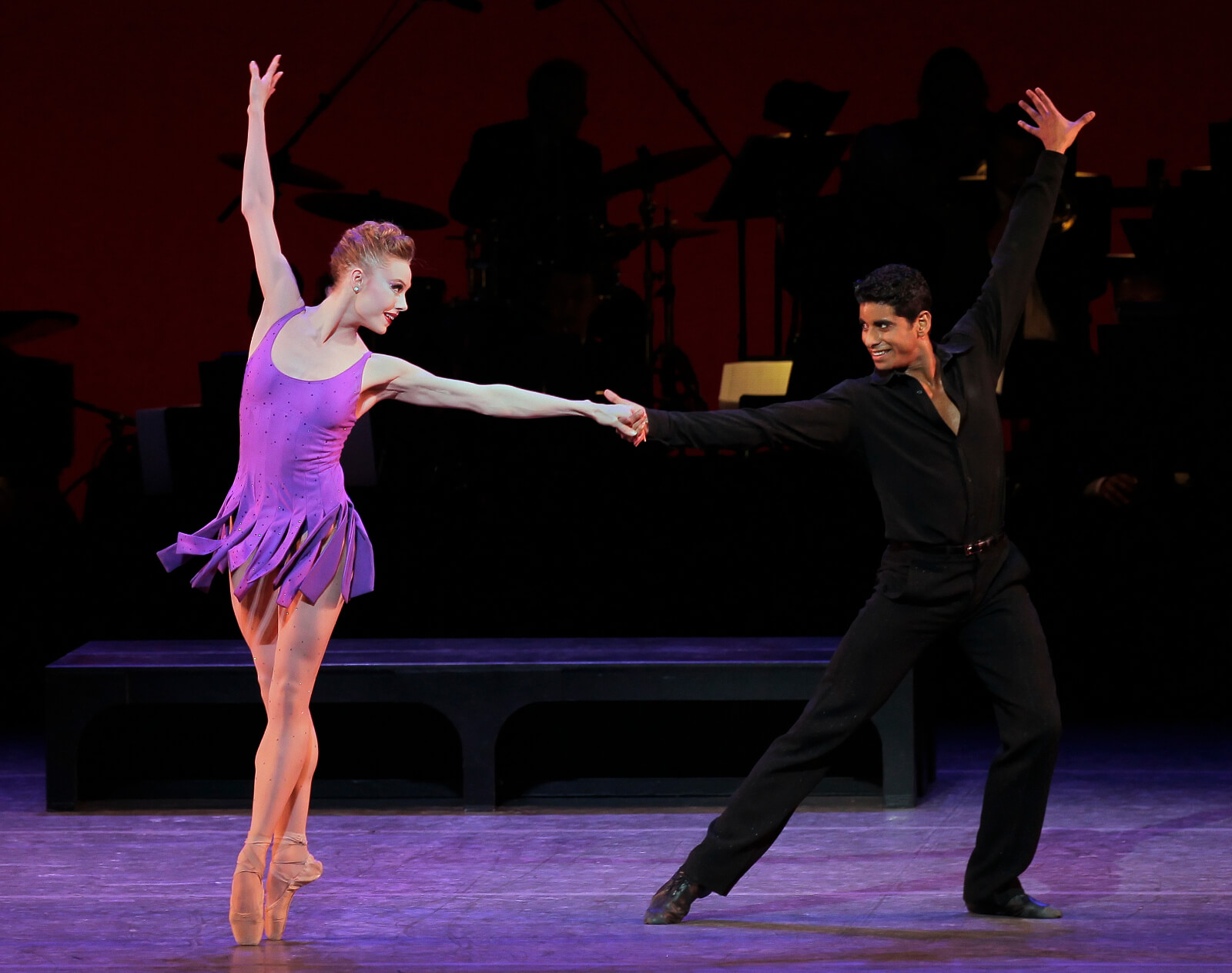 Frankie (Sara Mearns in purple) and Johnny (Amar Ramasar in all black) in a partnering section of For the Love of Duke.