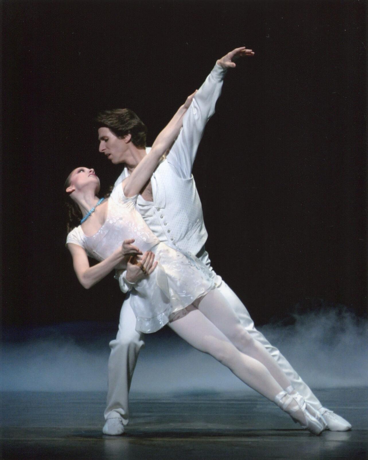Damian Woetzel and Ashley Bouder (both dressed in white) dance a pas de deux.
