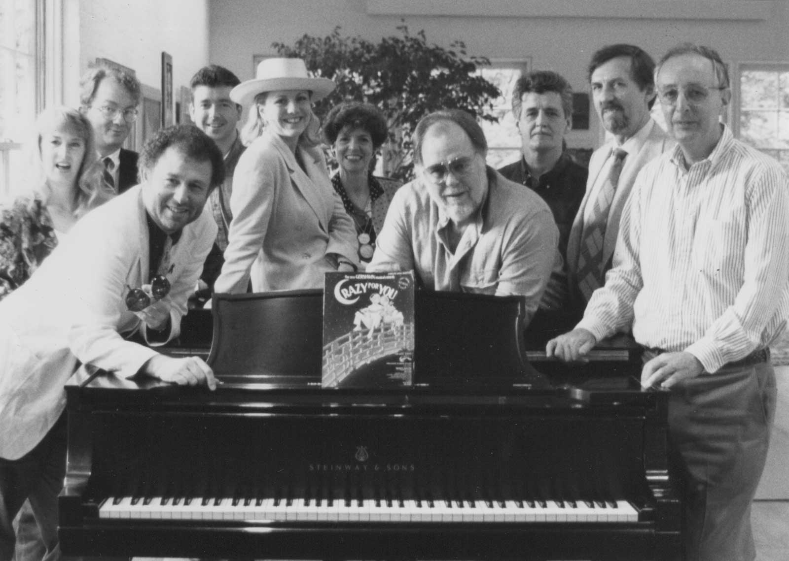 The Creative team of Crazy for You at the home of Producer Roger Horchow. Gershwin himself played that piano.