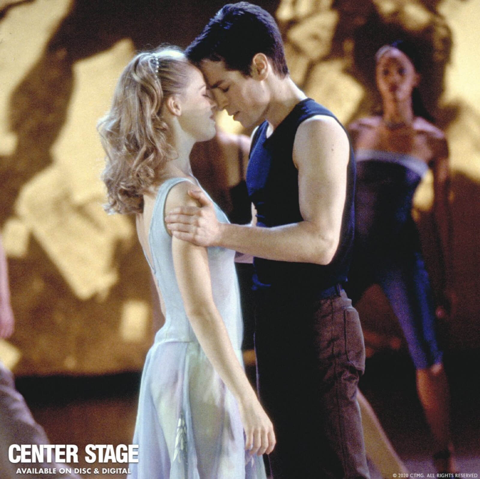 """Amanda Schull and Sascha Radetsky in a tender moment; foreheads touching and eyes closed dancing to """"If I Was the One""""."""