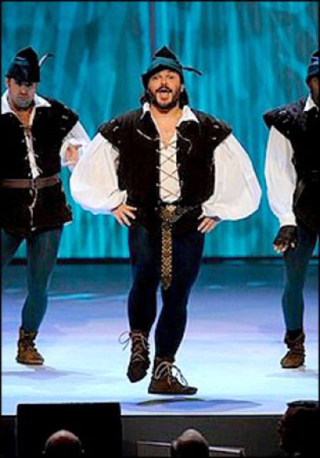 """Jack Black dances and sings """"Men in Tights"""", dressed as Robin Hood."""