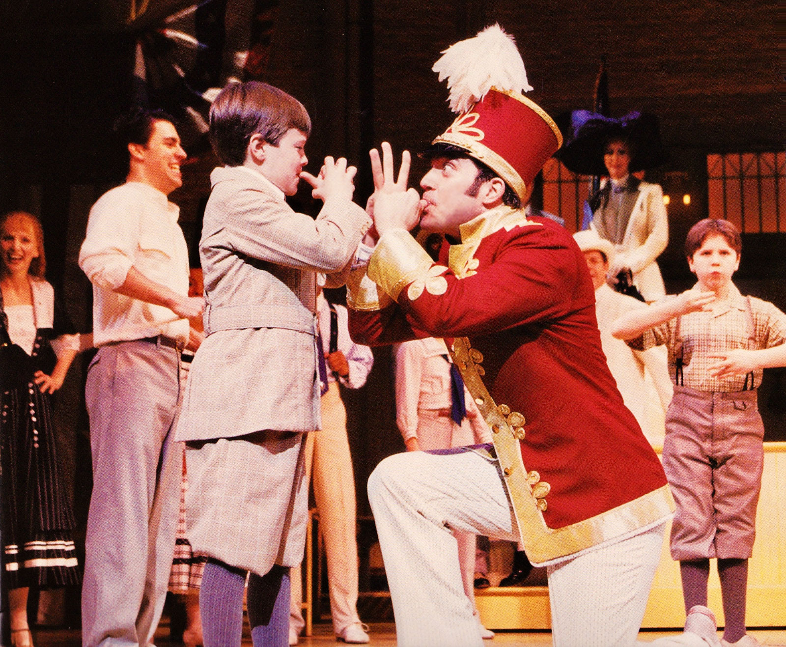 Harold Hill (Craig Bierko)teaching Winthrop (Michael Phelan) how to play the cornet.