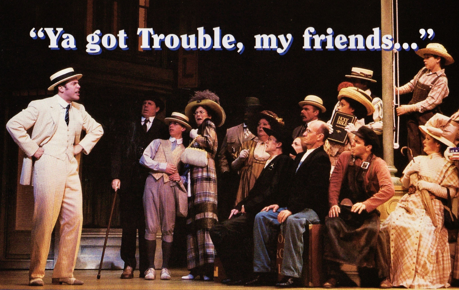 """Harold Hill (Craig Bierko)singing to the cast of The Music Man a line from """"Trouble"""". The cast are are very concerned."""