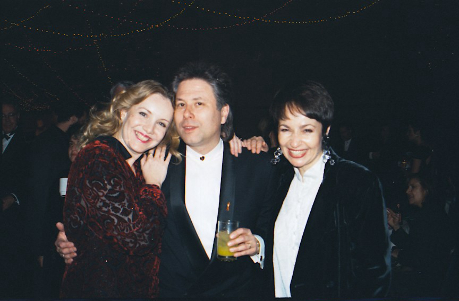 Susan Stroman, Alan Menken, and Lynn Ahrens dressed up and embracing on the opening night of A Christmas Carol.