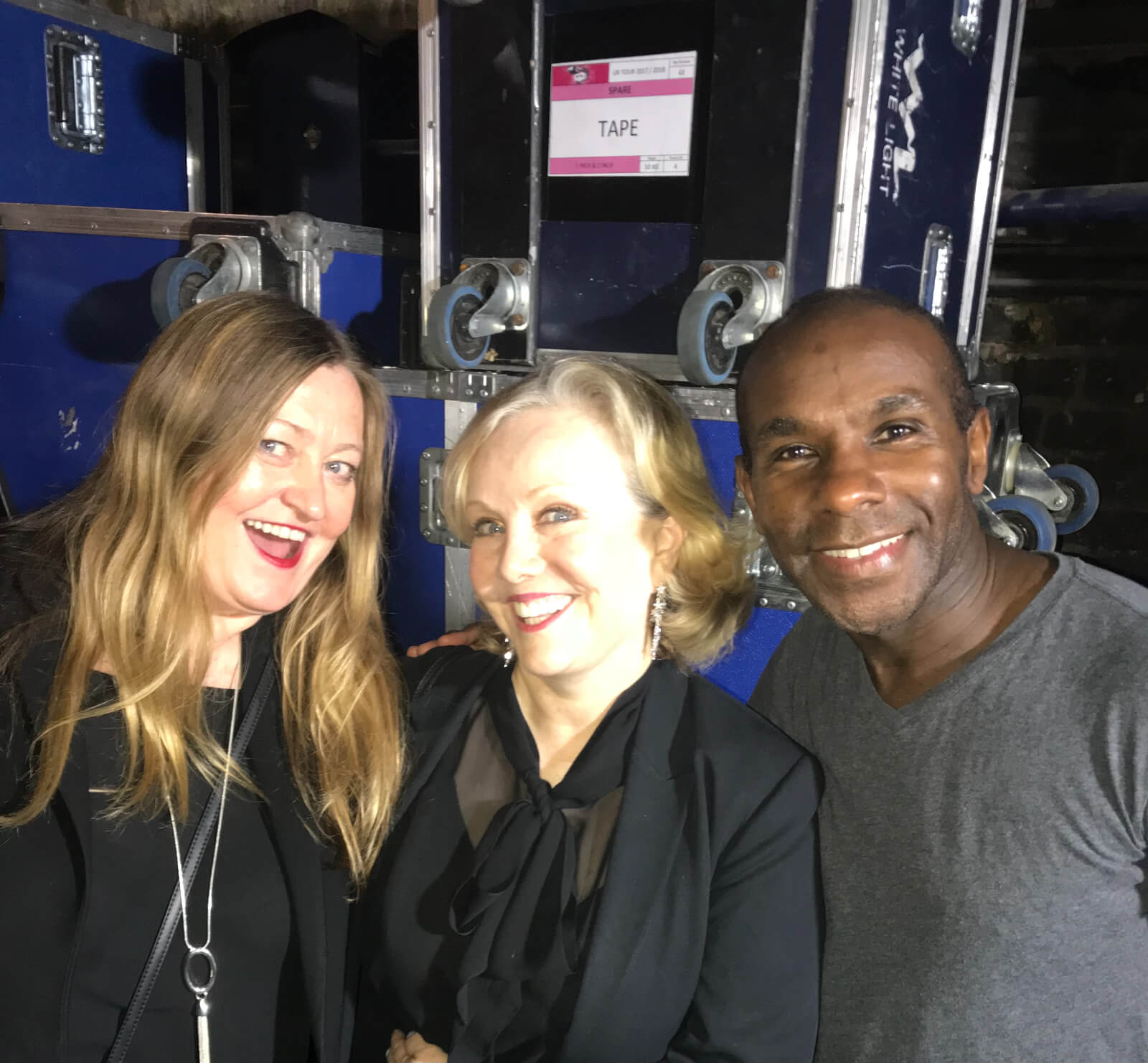 Casting Director Jill Green, Director Susan Stroman and Associate Choreographer Richard Pitt. They are backstage in front of blue equipment boxes.