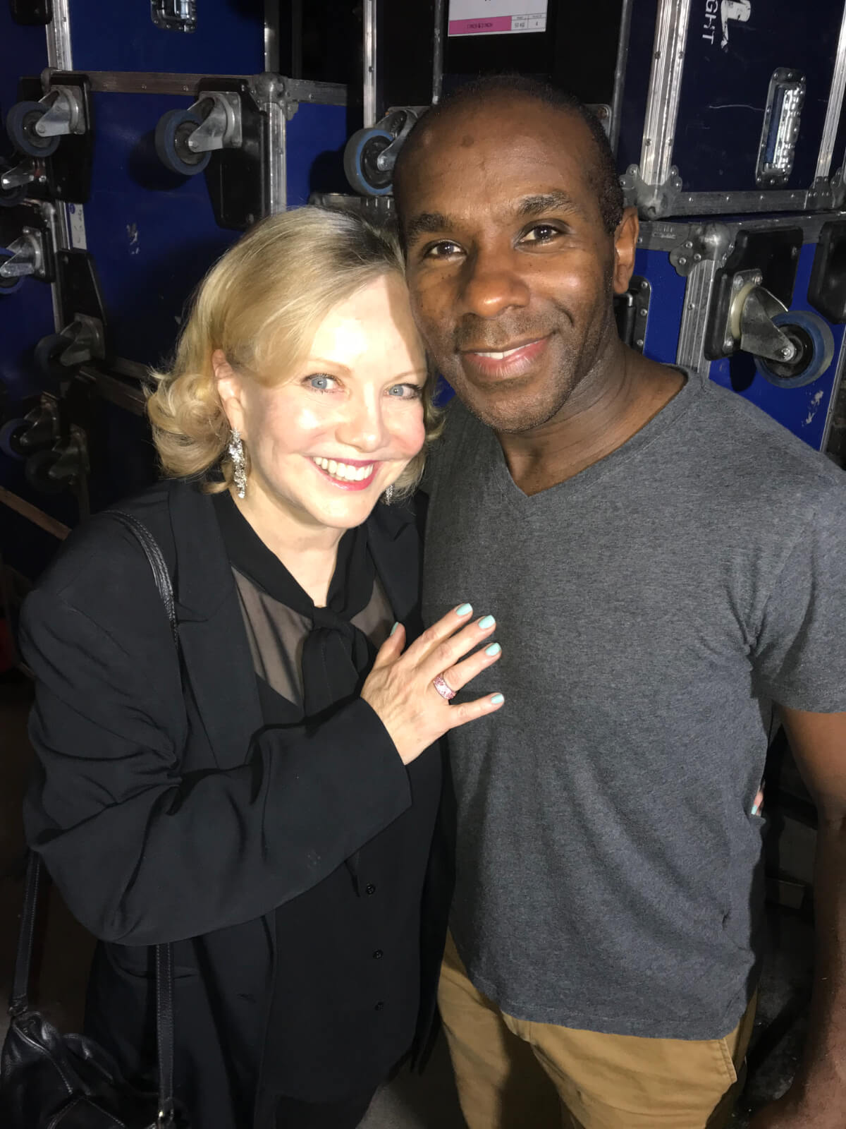 Susan Stroman with Associate Choreographer of West End's The Scottsboro Boys and Young Frankenstein, Richard Pitt. Both are backstage in front of blue equipment storage boxes.