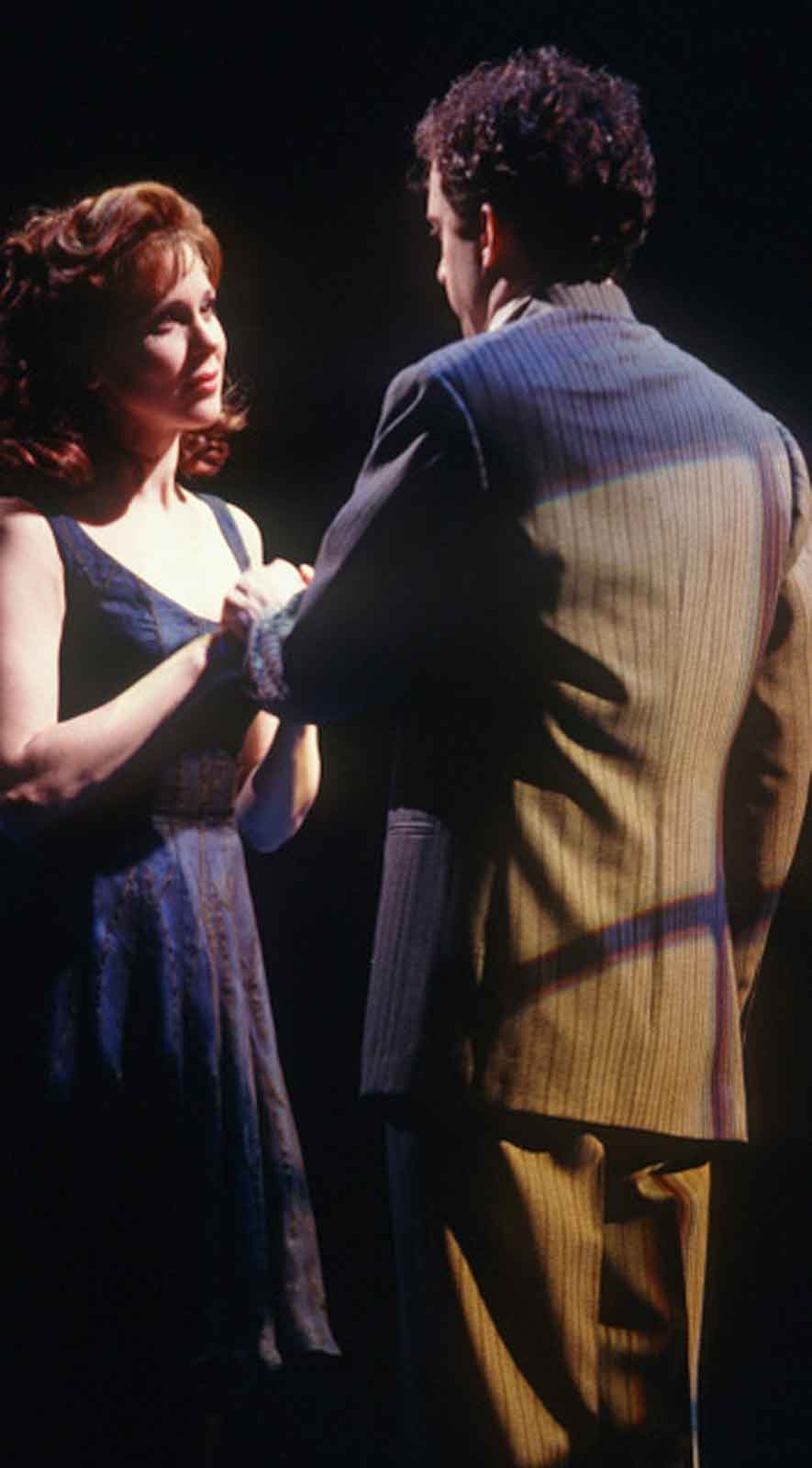 Susan (Christa Moore) and Josh (Daniel Jenkins) in Big. They stand facing each other. There is romance and energy.