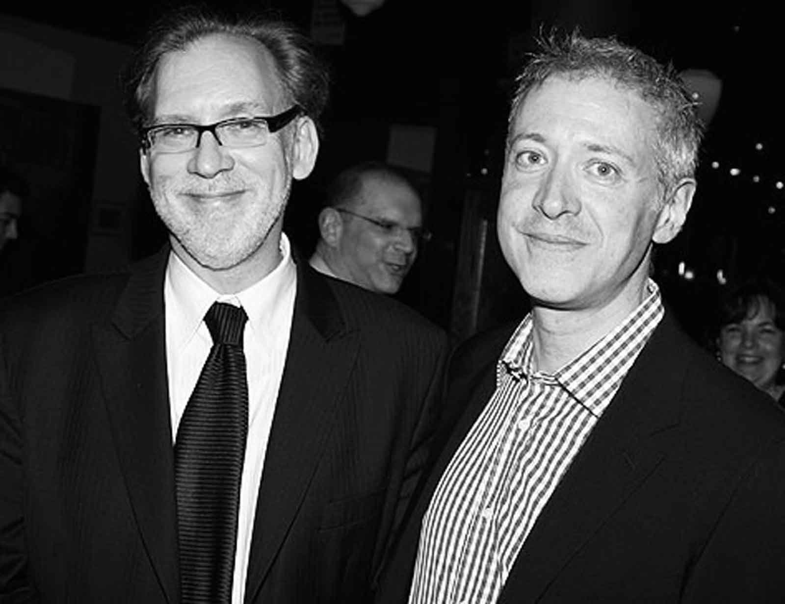 Black and white photo of Michael Korie and Scott Frankel, both wearing blazers.