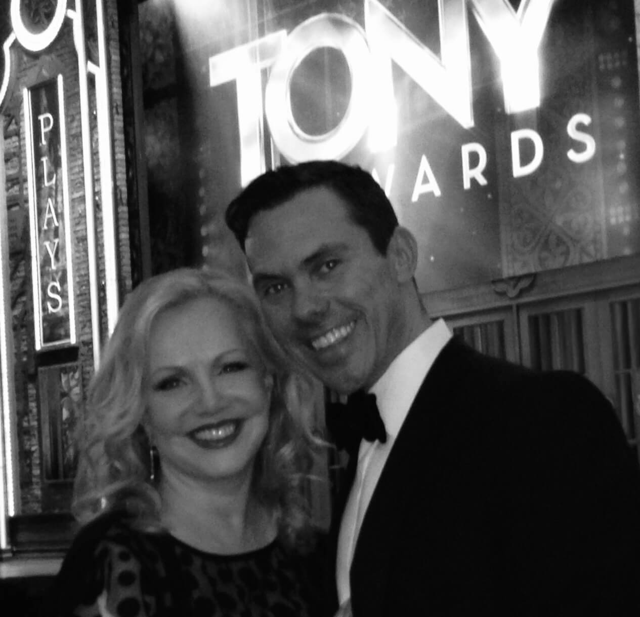 Black and white photo of Susan Stroman and Associate Choreographer James Gray at the Tony Awards. Both are dressed elegantly.