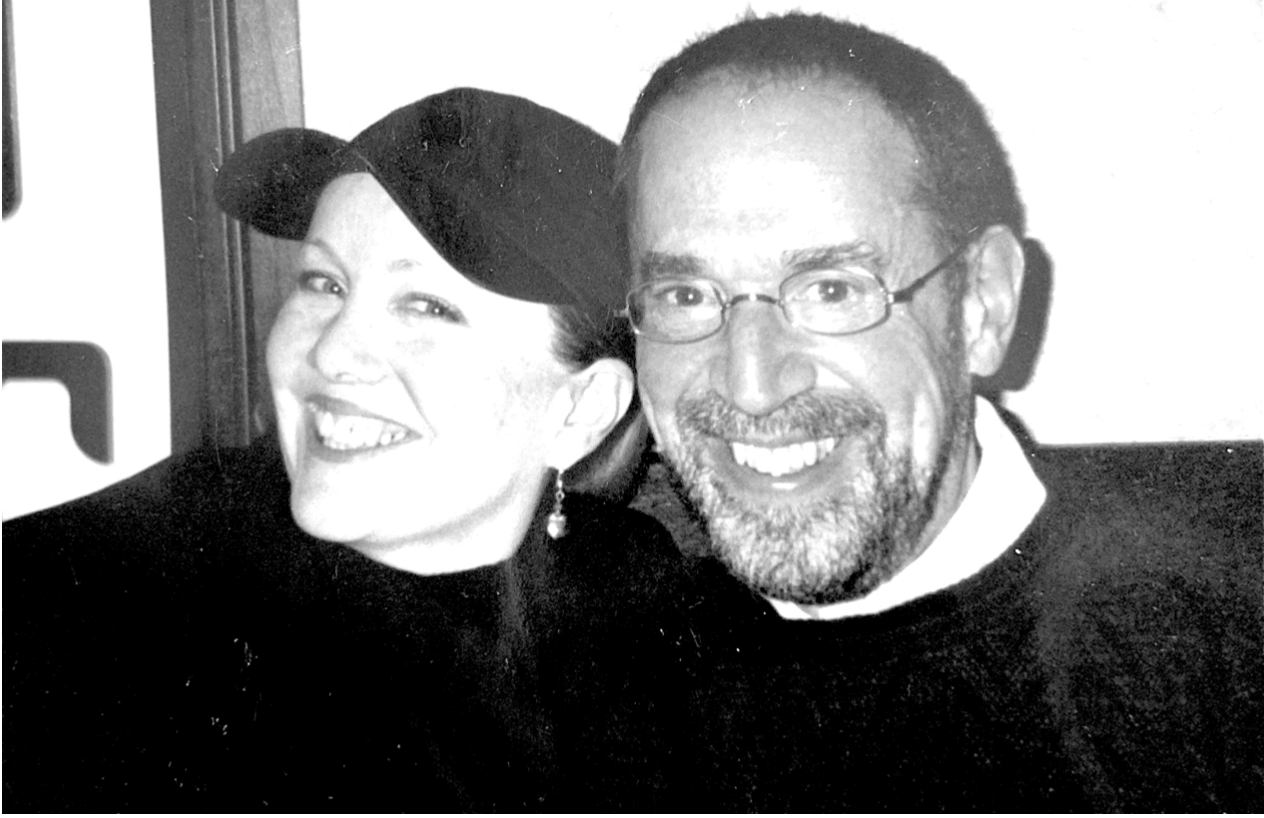 Black and white photo of Susan Stroman with Production Stage Manager, Steven Zweigbaum. Stroman is in her signature black hat.