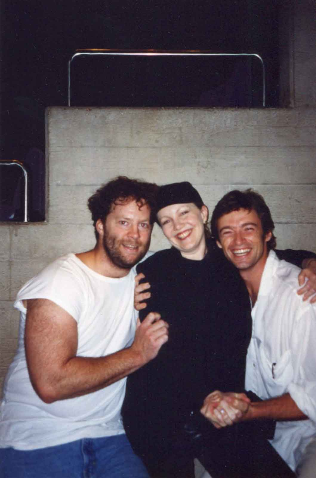 Hugh Jackman and Shuler Hensley both in white shirt and jeans with Susan Stroman herself, who's in an all-black outfit.