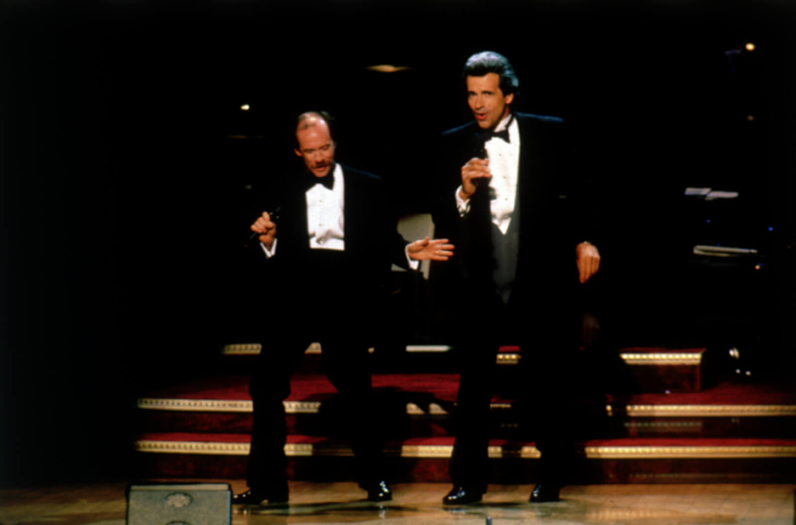 Michael Jeter and James Naughton. Both in suits, singing and dancing.