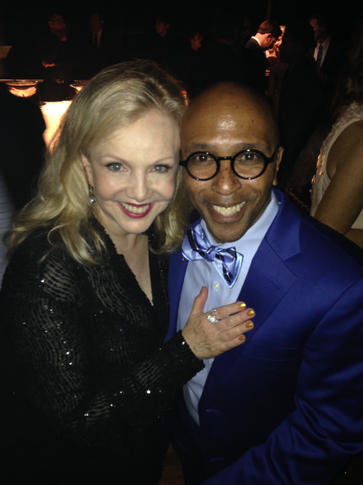 Susan Stroman and Tomé Cousin. Tomé is the Directing Supervisor for international and regional productions of Contact. Stro is wearing a sequined black outfit and Tomé is wearing a blue shirt, tie, suit, and glasses.