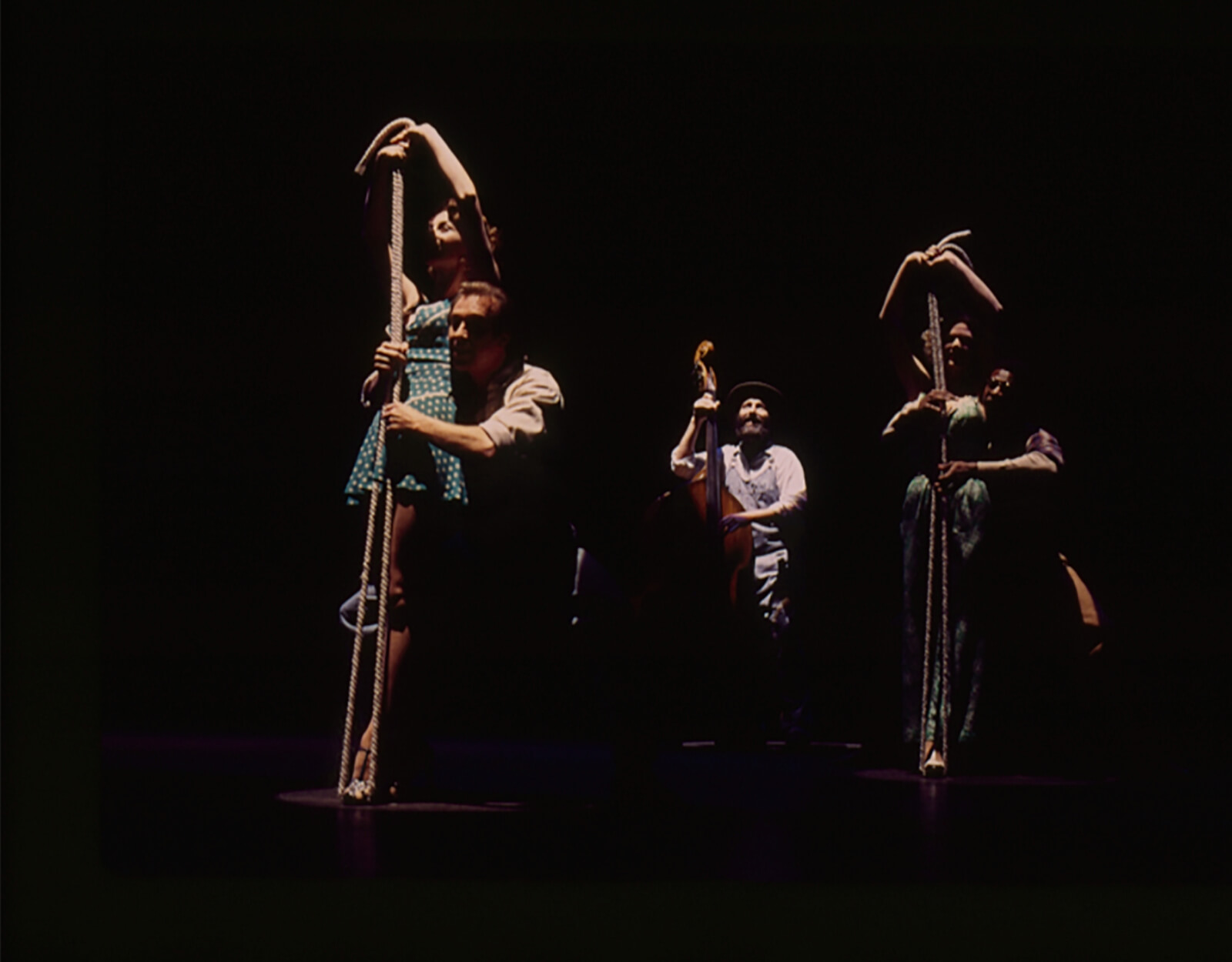 """""""SlapThat Bass""""from the Original Broadway Production. Women are standing over a folded rope while men play the rope like a Bass."""