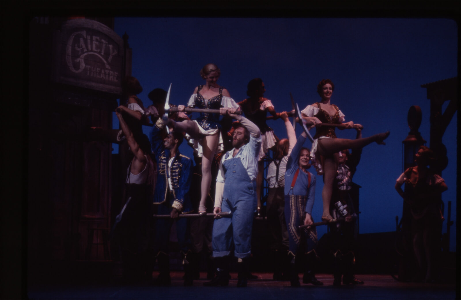 """""""I Got Rhythm"""" from the Original Broadway Production. Men are in a circle holding pick axes. Women stand on the axes above them kicking—a la Busby Berkeley."""