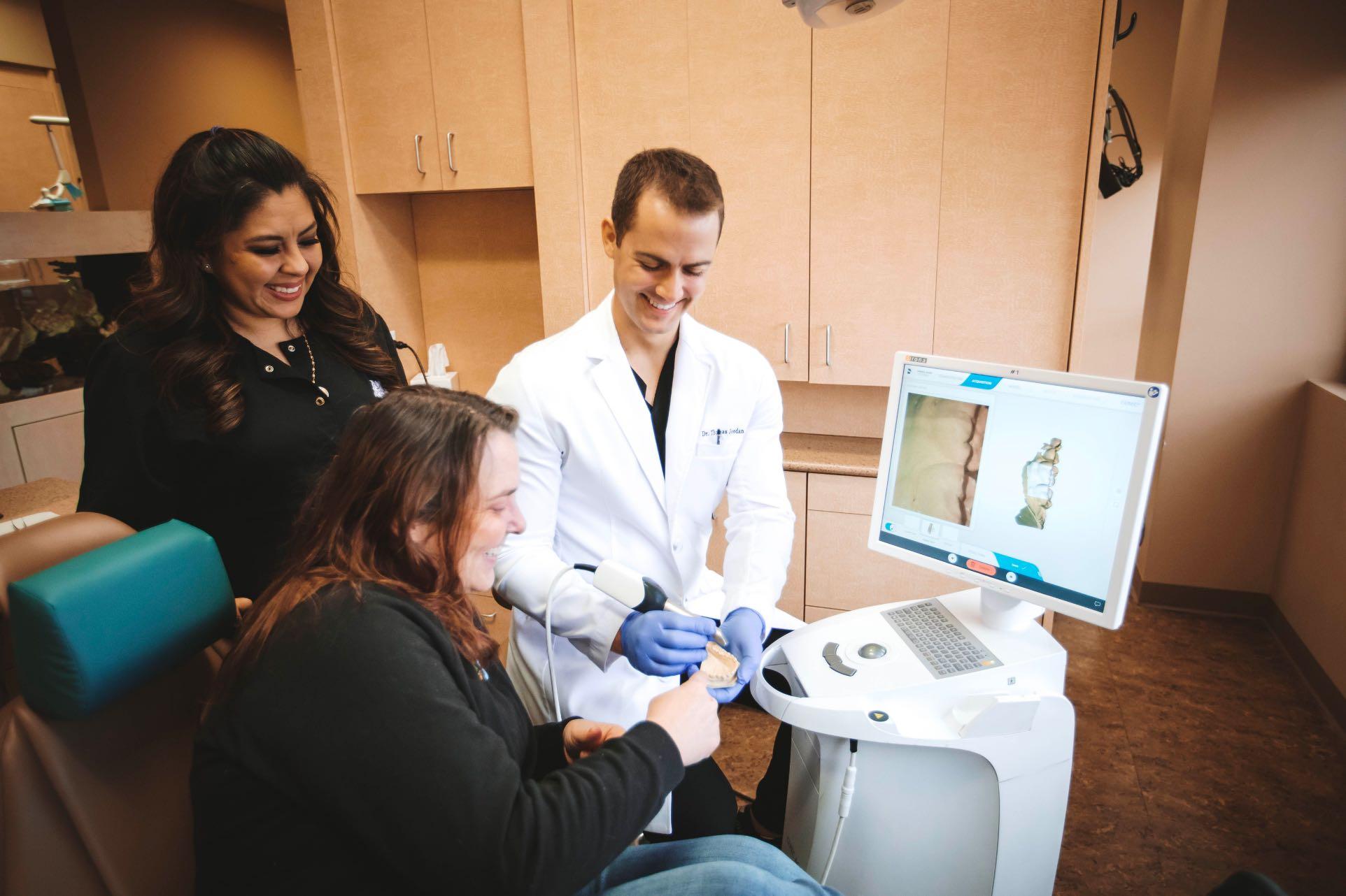 Photo of Dr. Jordan using a 3-D dental scanner