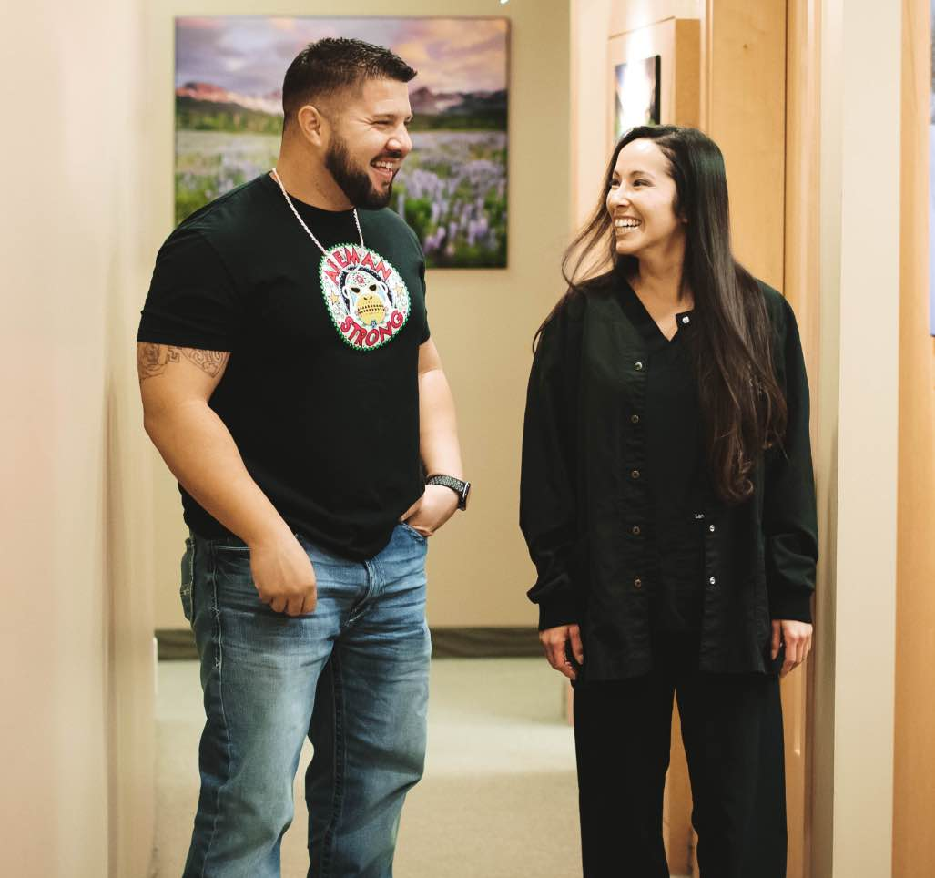Photo of a team member and a patient smiling at each other