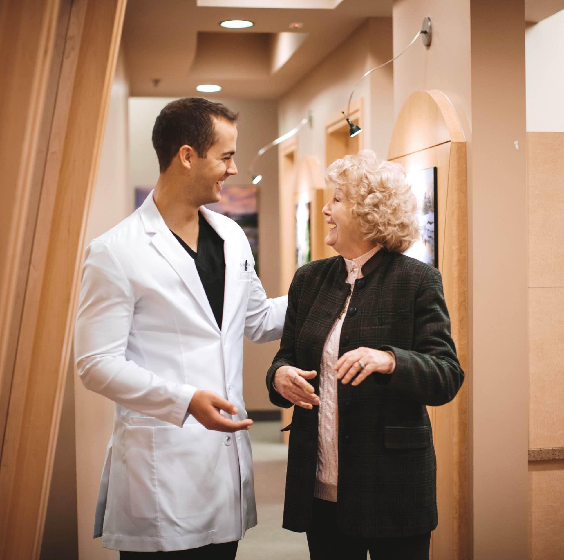 Photo of Dr. Jordan walking beside a smiling patient