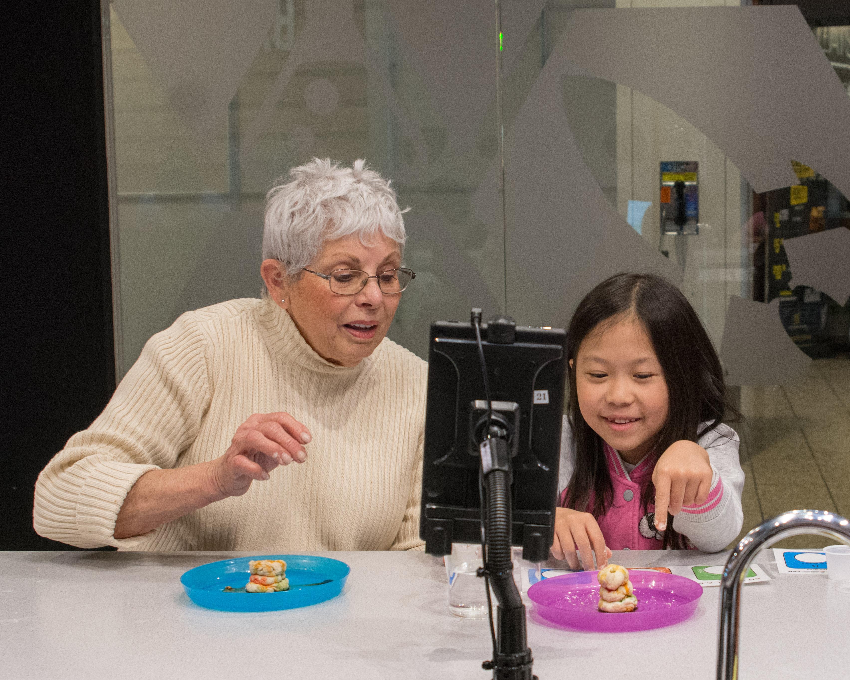 grandma teaching small child