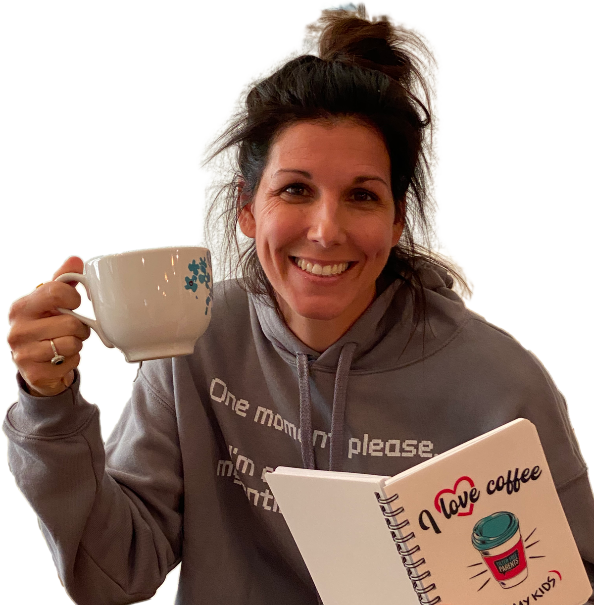 Meredith Masony drinking coffee with her 'I Love Coffee + my kids' notebook in 'one moment please' cropped Hoodie from her official merch line with Bonfire
