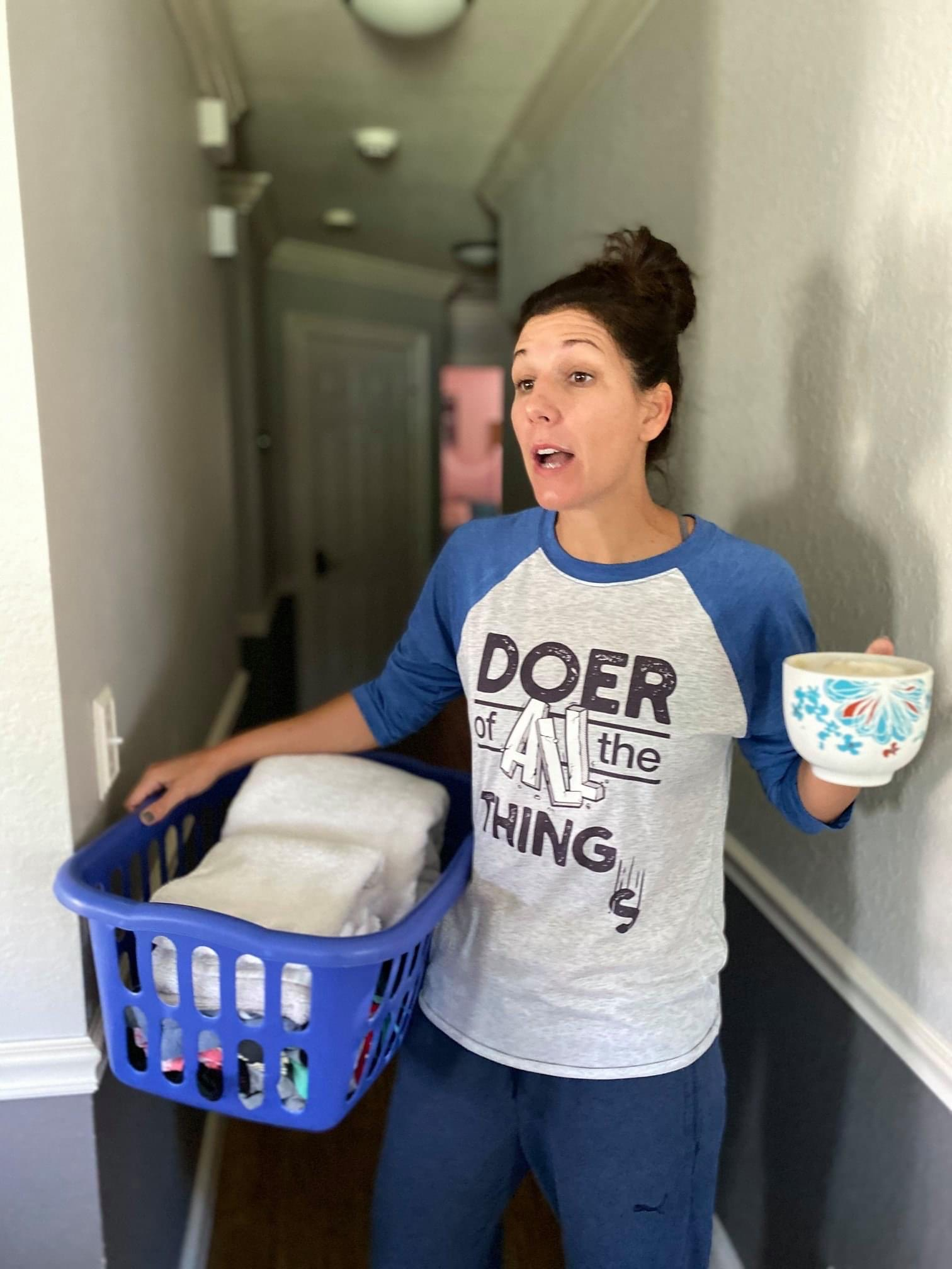 Meredith Masony doing laundry wearing her 'Doer of all the things' merch with Bonfire