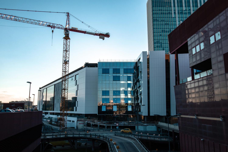 Commercial crane next to buildings