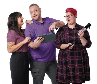 three great clips employees laughing and gathered around a tablet computer