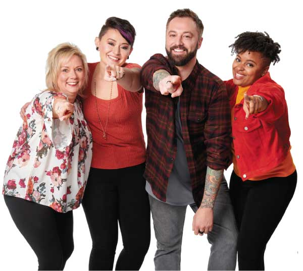 three female and one male stylist standing together and pointing at the camera smiling