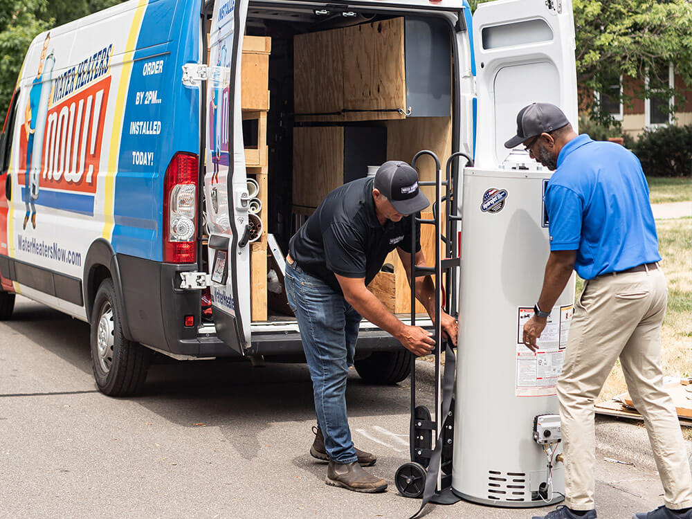 Water Heaters Now techs unloading a water heater.