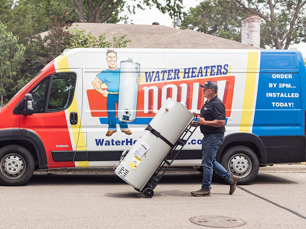 A Water Heaters Now tech unloading a water heater.