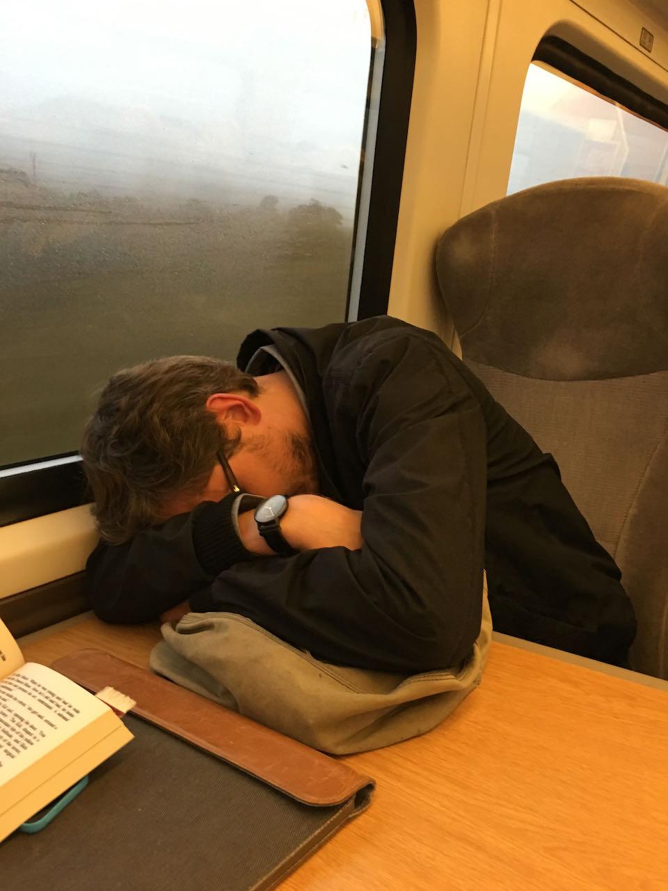 Espen asleep on the train